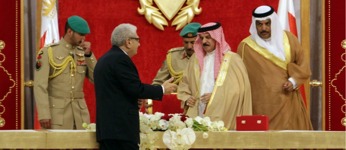 Cherif Bassiouni, second from left, head of the commission charged with investigating Bahrain's uprising which took place earlier this year presents a report to Bahrain's King Hamad bin Isa Al Khalifa, second from right, in Sakhir Palace in Sakhir, Bahrain, Wednesday, Nov. 23, 2011. In a stinging blow to Bahrain's leaders, a special commission that investigated the kingdom's unrest charged Wednesday that authorities used torture, excessive force and fast-track justice in crackdowns on the largest Arab Spring uprising in the Gulf. (AP Photo/Hasan Jamali)