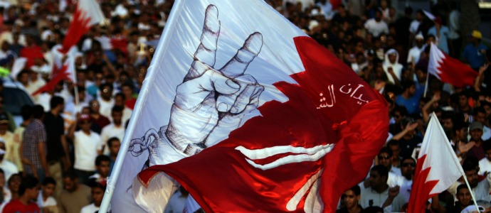 Anti-government protesters wave Bahraini flags and chant during a peaceful march Friday, Sept. 9, 2011, in Muqsha, Bahrain, west of the capital of Manama.