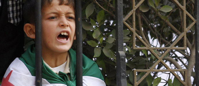 A Syrian boy shout slogans against Syrian President Bashar al-Assad during a protest before the Arab League foreign ministers emergency meeting, at the Arab League headquarters in Cairo November 2, 2011 (Reuters).