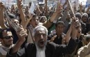In this Tuesday, Dec. 6, 2011 file photo, a Yemeni protestor holds a dagger and chants slogans during a demonstration demanding the prosecution of President Ali Abdullah Saleh in Sanaa, Yemen. The case is often made that Washington was caught flatfooted by the Arab Spring and now must adapt to diminished influence in the Middle East. But declaring a twilight for America in the Mideast ignores a big caveat: The deep U.S. connections in the Persian Gulf have so far ridden out the upheavals and are increasingly flexing their political clout around the Arab world. (AP Photo/Hani Mohammed)