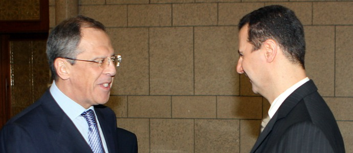 Syrian President Bashar Assad, right, with Russian Foreign Minister Sergei Lavrov (AP Image).