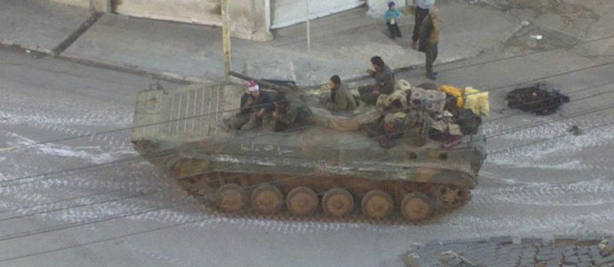 A Syrian army tank is seen in the neighbourhood of Zabadani