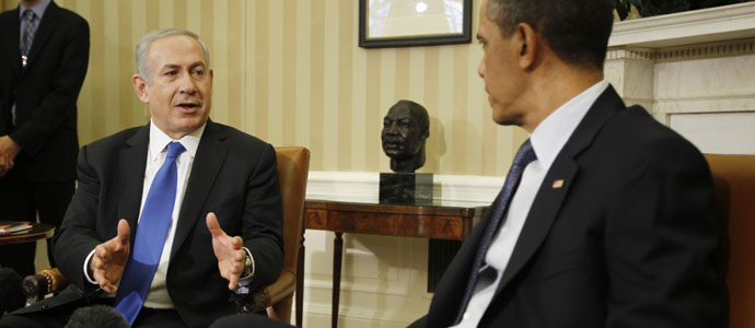 U.S. President Barack Obama listens to Israel's Prime Minister Benjamin Netanyahu in the Oval Office of the White House