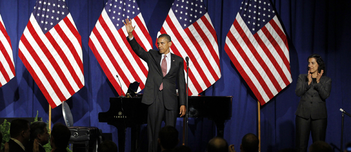 U.S. President Barack Obama waves to the audience at a gala fundraiser for the gay community in New York City