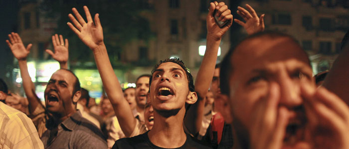 Protesters shout during a demonstration against presidential candidates Mohamed Mursi and Ahmed Shafiq at Tahrir Square in Cairo