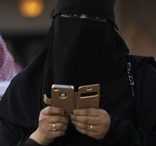 FILE - A Saudi woman is seen using an iPhone at a festival on the outskirts of Riyadh. (Reuters)