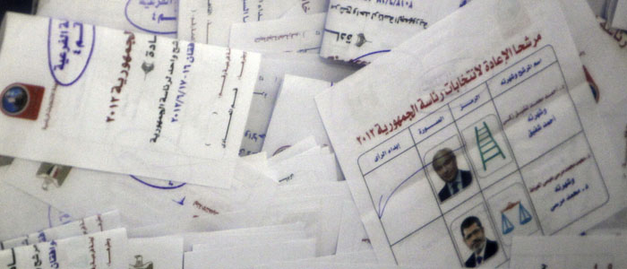 Ballots for Egypt's presidential elections are seen in a ballot box at a polling station in Cairo