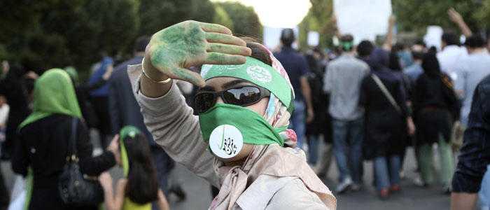 A protester takes part in a silent demonstration against the results of the Iranian presidential election in central Tehran