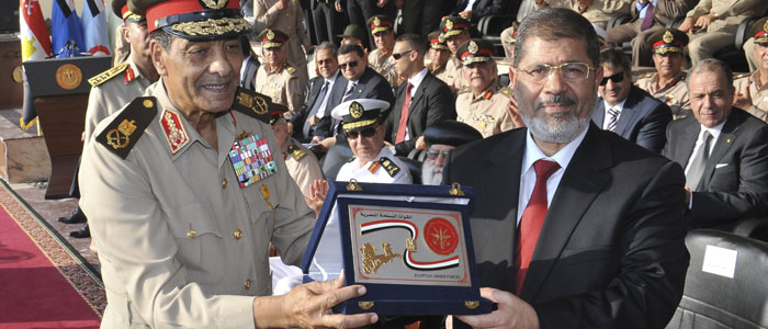Egypt's new President Morsi (R) with Field Marshal Tantawi, head of Egypt's ruling SCAF (Reuters).