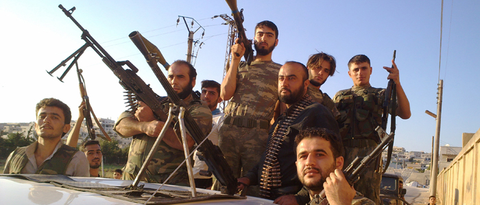 Free Syrian Army fighters are seen at Sermada near Idlib, August 12, 2012. (Reuters)