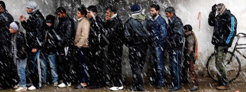 (file) Men wait to buy bread in front of a bakery shop during winter in Al Qusayr, a city in western Syria about 4.8km (3 miles) southwest of Homs, March 1, 2012.