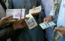 Afghan money changers gather to deal with foreign currency at a money change market in Herat October 4, 2012. Afghanistan has imposed a cap on U.S. dollar flows across the border with Iran amid clashes there between Iranian police and protesters prompted by a collapse in the rial currency, Afghan police said on Thursday. REUTERS
