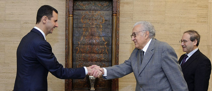 Syria's President Assad shakes hands with UN-Arab League peace envoy for Syria Brahimi before a meeting in Damascus