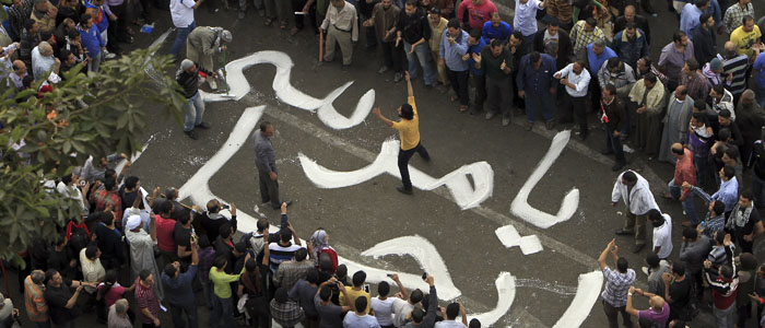 Protesters chant slogans against Egyptian President Mursi during a demonstration at Tahrir square in Cairo