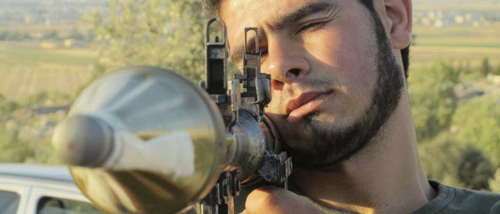 A member of Free Syrian Army attends a daily training at Sarmada