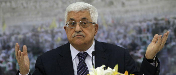 Palestinian President Abbas gestures during a news conference in Ramallah
