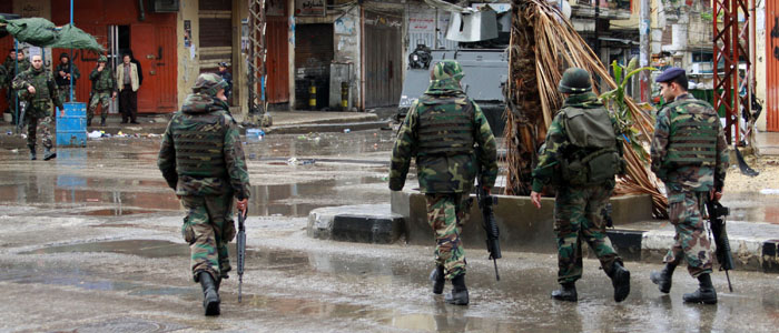 Lebanese Army soldiers patrol the Sunni Muslim Bab al-Tebbaneh neighbourhood in Tripoli, northern Lebanon