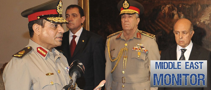 Egypt's new Defence Minister Abdel Fattah al-Sissi receives his orders at the presidential palace in Cairo