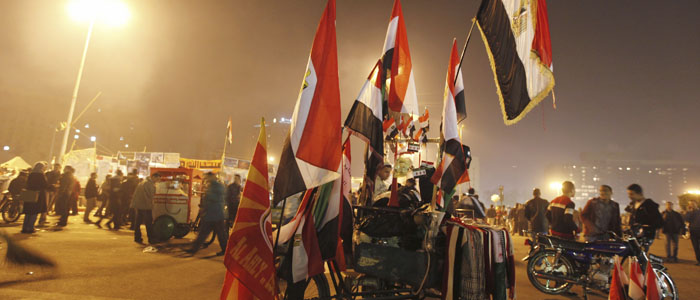 Egyptian flags are displayed for sale during New Year's Eve celebrations at Tahrir Square in Cairo