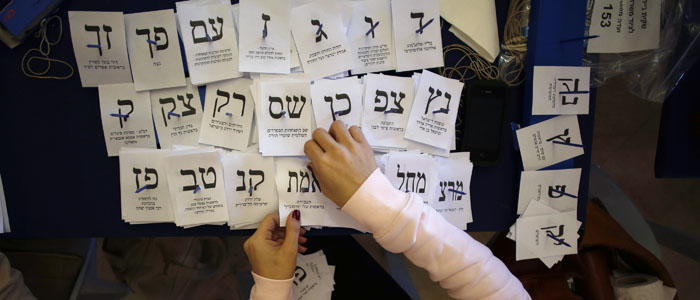 An Israeli election official tallies votes at the Knesset in Jerusalem