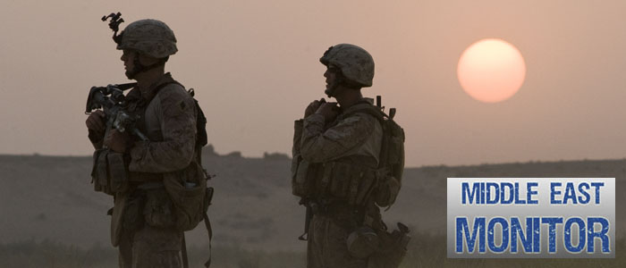 U.S. Marines wait for a helicopter during a Western Engagement operation in Garsmir district of Helmand province
