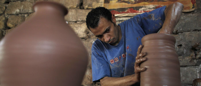 A man moulds clay at a workshop in Cairo