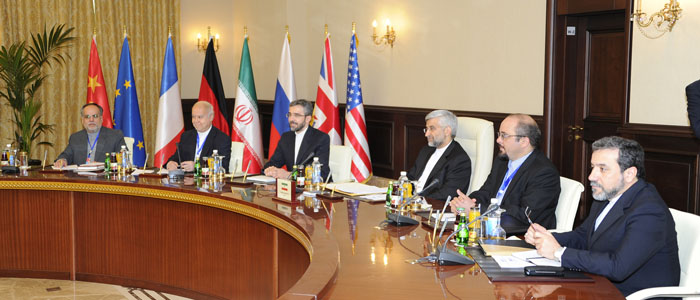 Iran's chief negotiator Saeed Jalili (3rd R) and his delegation attend a meeting with representatives of the U.S., Russia, China, Germany, France and Britain in Baghdad