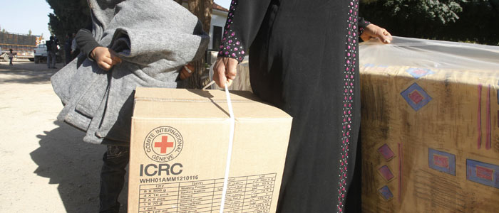 Syrian refugees receive humanitarian aid from the International Committee of the Red Cross (ICRC) at Masharih Al-Qaa in Bekaa Valley
