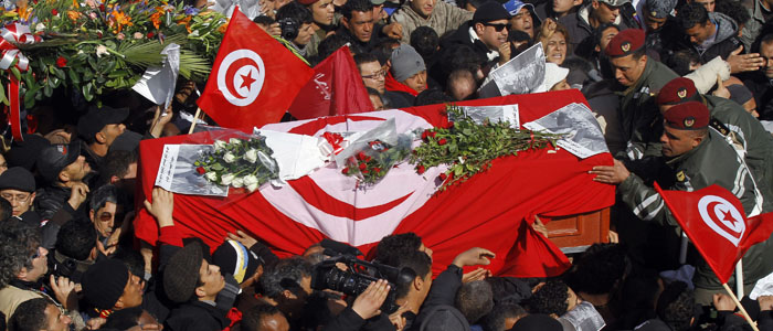 Soldiers help mourners carry the coffin of slain opposition leader Chokri Belaid during his funeral procession towards the nearby cemetery of El-Jellaz, where he is to be buried, in the Jebel Jelloud district of Tunis