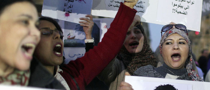 Women chant slogans as they participate in a protest against sexual harassment, in central Cairo