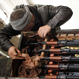 A Syrian rebel fighter checks weapons seized at an army base in Hawa village, north of Aleppo December 23, 2012.
