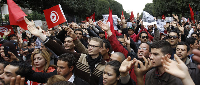 Tunisians chant slogans and hold pictures of assassinated leftist politician Belaid during demonstration against Islamist Ennahda movement in Tunis