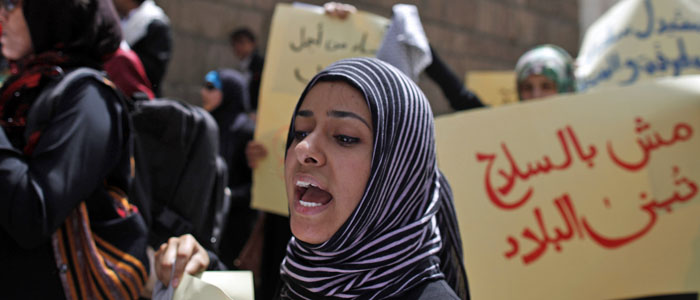 A woman shouts slogans during a protest to mark International Women's Day in downtown Sanaa