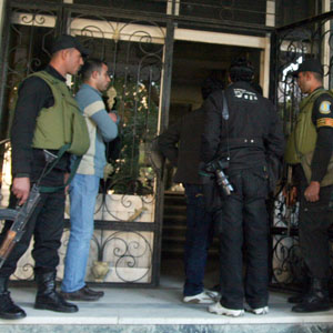 Egyptian soldiers stand guard as government agents raid an NGO office in Cairo December 29, 2011. (AP)