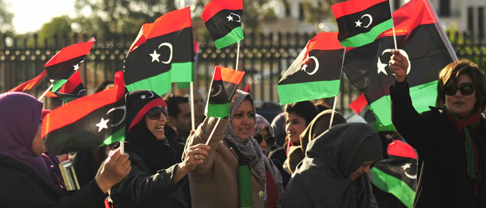 Women wave Libyan flags during celebrations commemorating the second anniversary of the Feb. 17 revolution in Benghazi