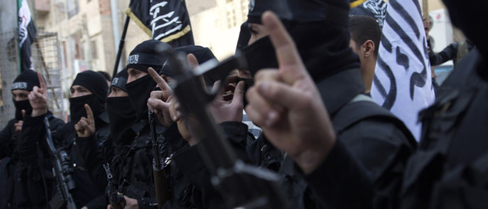 Members of an Islamist group hold their weapons during an anti-Assad protest. (Reuters file)