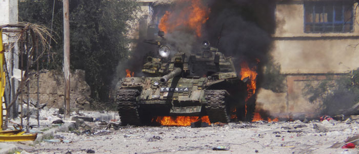 A burning Syrian government tank is seen in Daraa March 9, 2013. (Reuters)