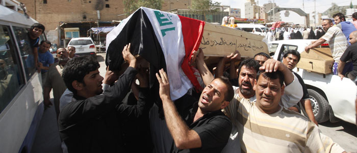 Men carry the coffin of a bomb attack victim, at a funeral in Najaf, 160 km south of Baghdad, April 27, 2013. (Reuters)