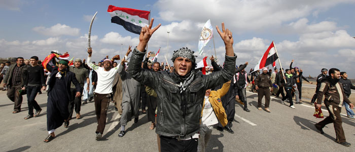 Iraqi Sunni Muslims shout slogans during an anti-government rally in Falluja, 50 km west of Baghdad. (Reuters file)