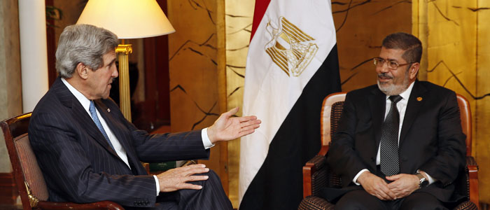 U.S. Secretary of State John Kerry (L) is seen meeting with Egyptian President Mohamed Morsi (Reuters file).