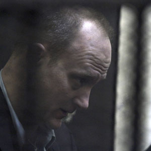 American Robert Becker, one of the defendants, is seen standing in a cage during the early days of the NGO trial in Cairo March 8, 2012. (Reuters)