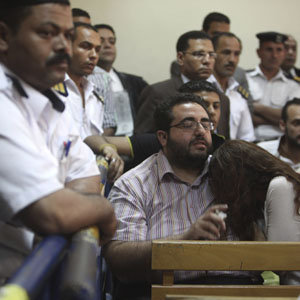 Friends of Egyptian defendants react as they listen to the judge's verdict during court proceedings against NGO workers, Cairo, June 4, 2013. (Reuters)