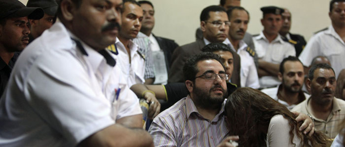 Friends of Egyptian defendants react as they listen to the verdicts rendered at the NGO trial in Cairo June 4, 2013. (Reuters)