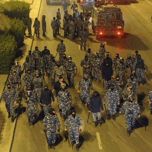 Anti-riot police are mobilized as demonstrators rally againt election results in Kuwait City December 4, 2012. (Reuters)