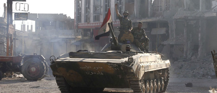 Syrian government soldiers gesture atop their tank after entering Qusair June 5, 2013. (Reuters)