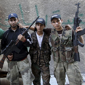 Syrian rebel fighters pose for a picture in Aleppo June 11, 2013. (Reuters)