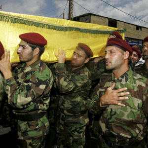 Hezbollah fighters carry the coffin of a comrade killed in the Syrian conflict, during his funeral in Beirut May 26, 2013. (Reuters)