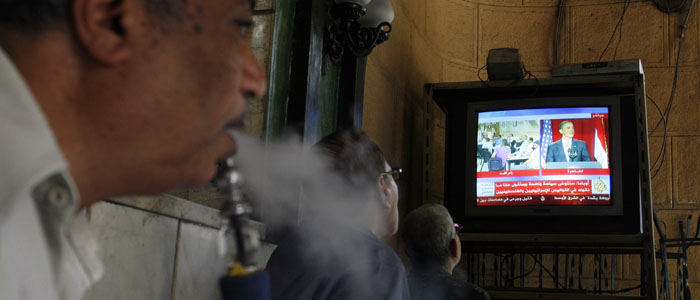 Egyptians watch US President Barack Obama's June 4, 2009, Cairo speech on television (Reuters file).