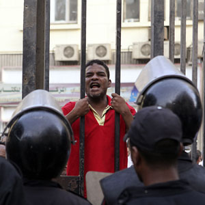 An anti-Morsi protester shouts slogans outside the Supreme Court in Cairo, June 3, 2013 (Reuters)