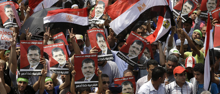 Supporters of Egypt's ousted president, Mohamed Morsi, are seen at a rally in Cairo July 12, 2013 (AP).
